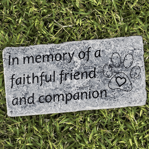 Round stone with lab engraved in center. Wording around 'In Loving Memory of Miles, Forever in our hearts'