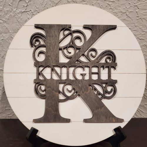 """Stone circle with wording etched in as well as the word """"Sparkle"""" cut out of wood and attached to front"""