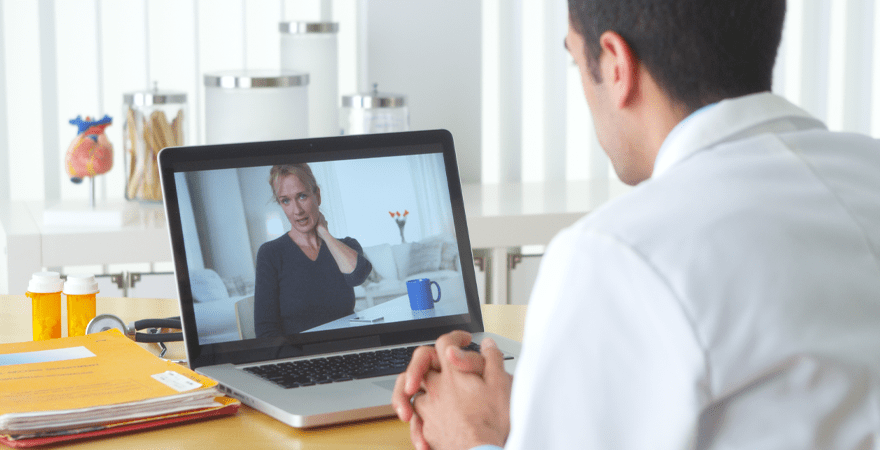 Doctor consulting with patient through televisit