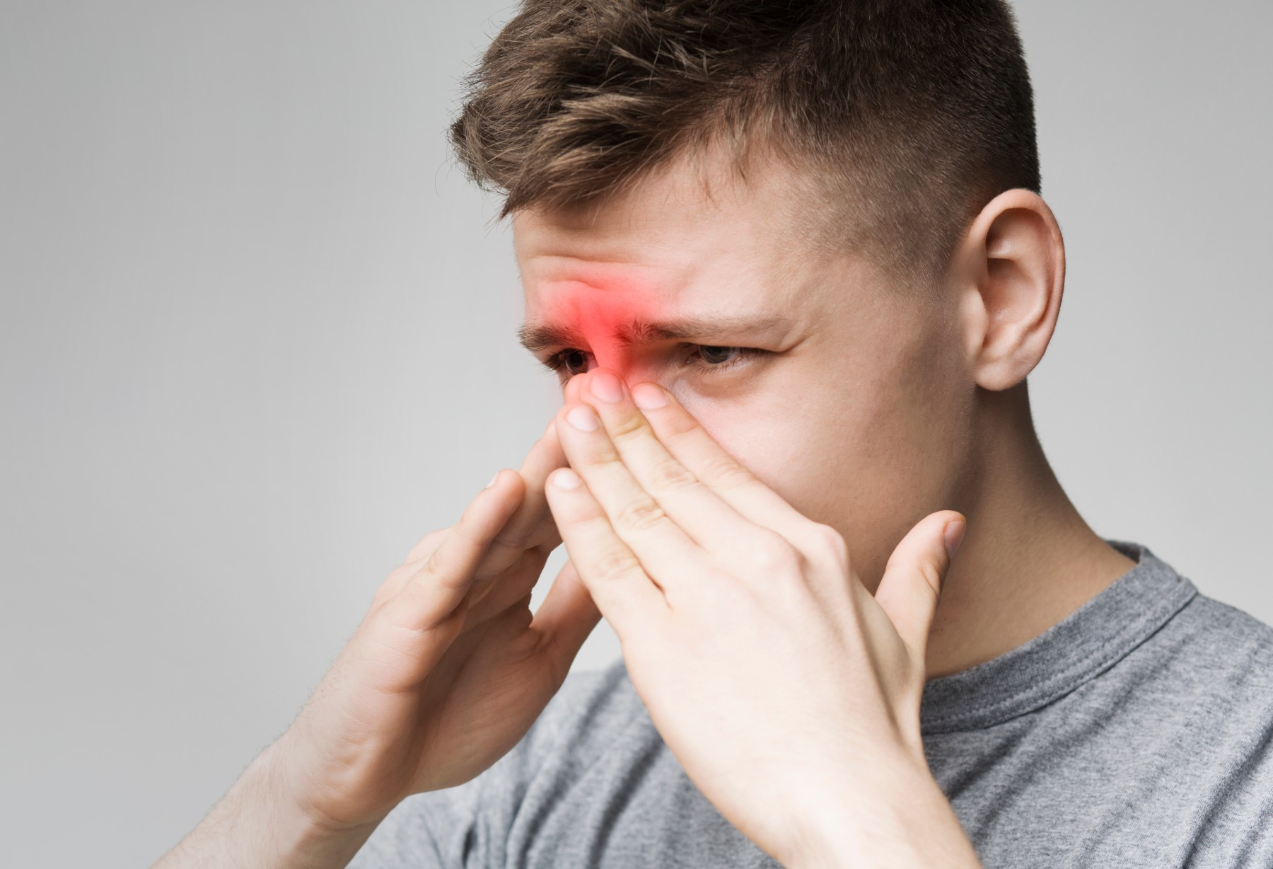 Main with sinus pain and pressure in head