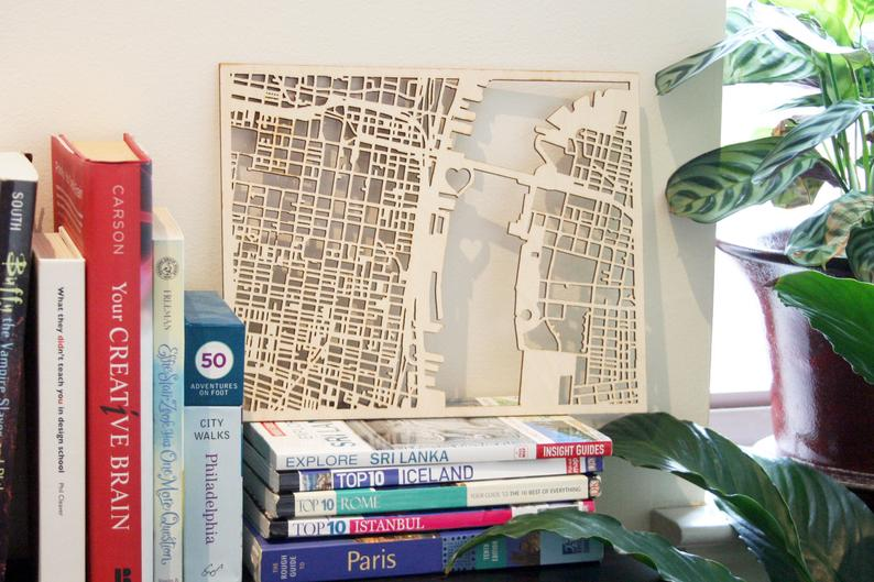 Philly Love notes Custom woodcut map on a bookshelf