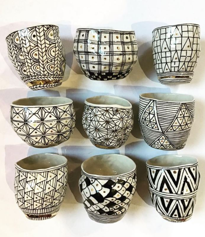 9 bowls from Suzanne Sullivan Ceramics,  variety of hand painted patterns