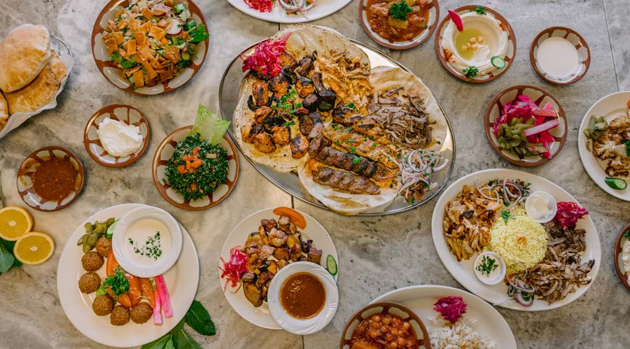 A table full of Mediterranean ingredients and dishes