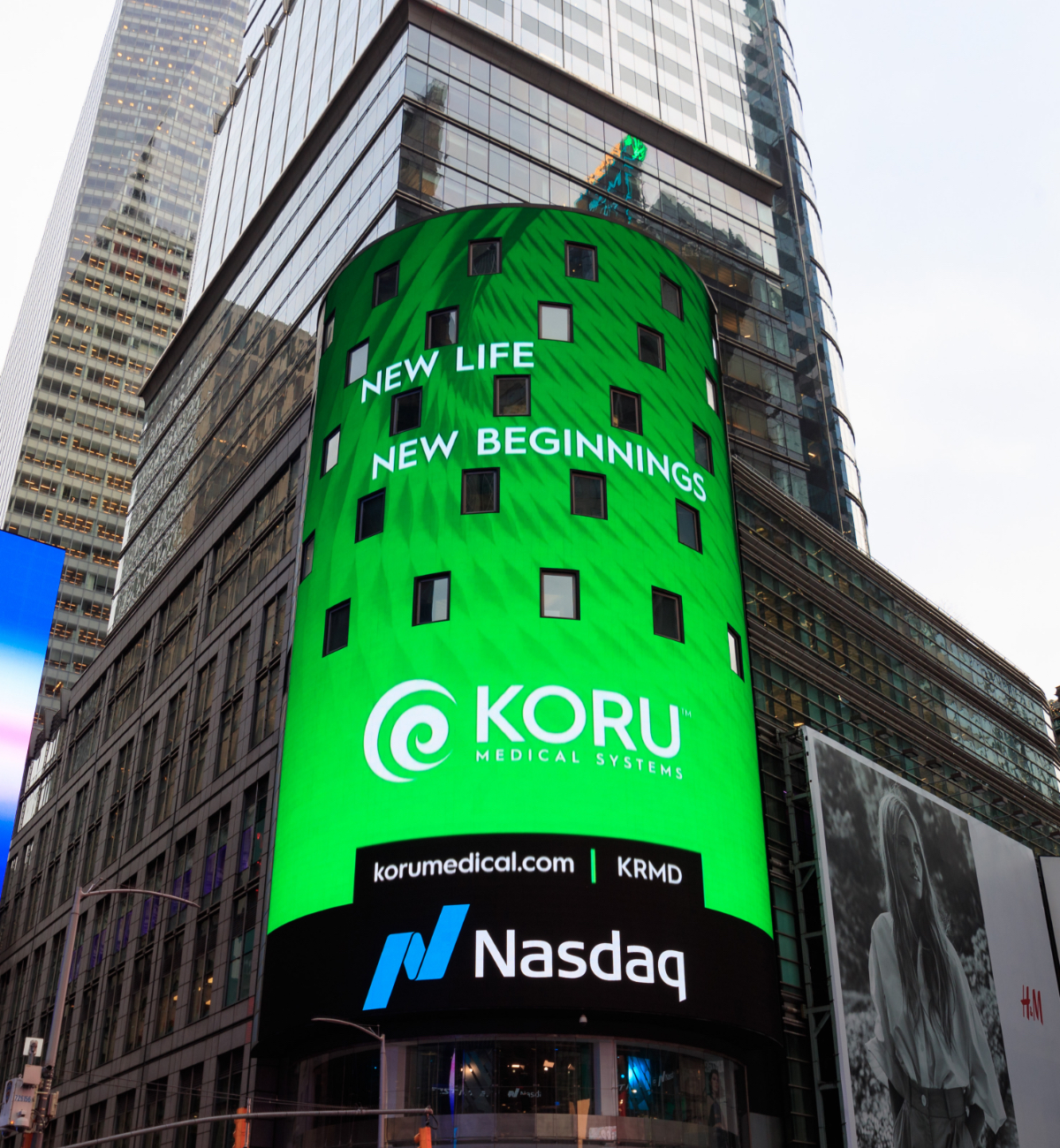 Koru Medical Systems advertisment on a big digital screen on the side of a building