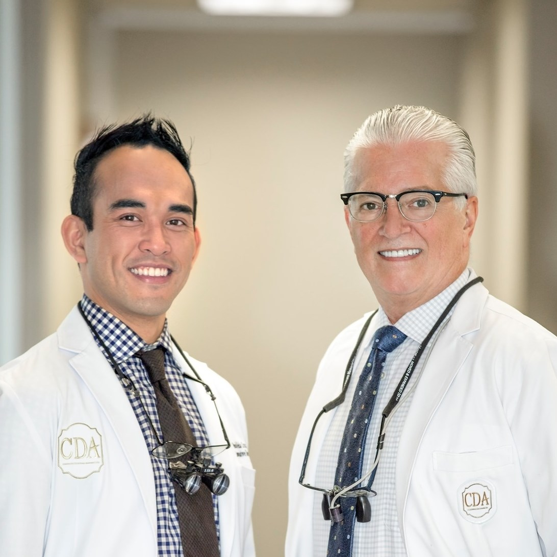 Dr. Landry + Dr. Cruz smiling in the office