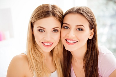 2 woman smiling together