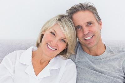 an older couple smiling together