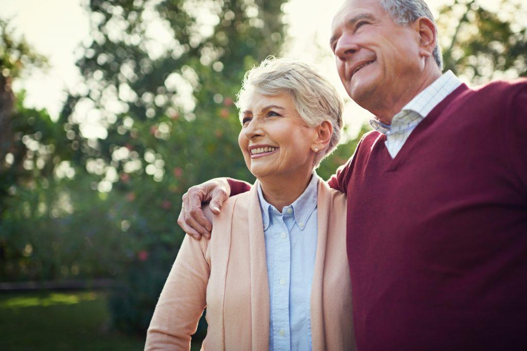 an older couple walking together