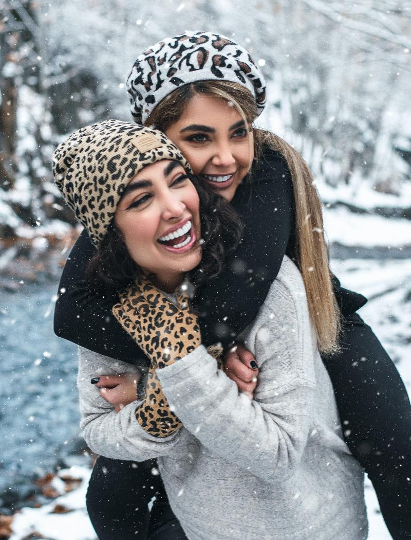 friends in the snow smiling