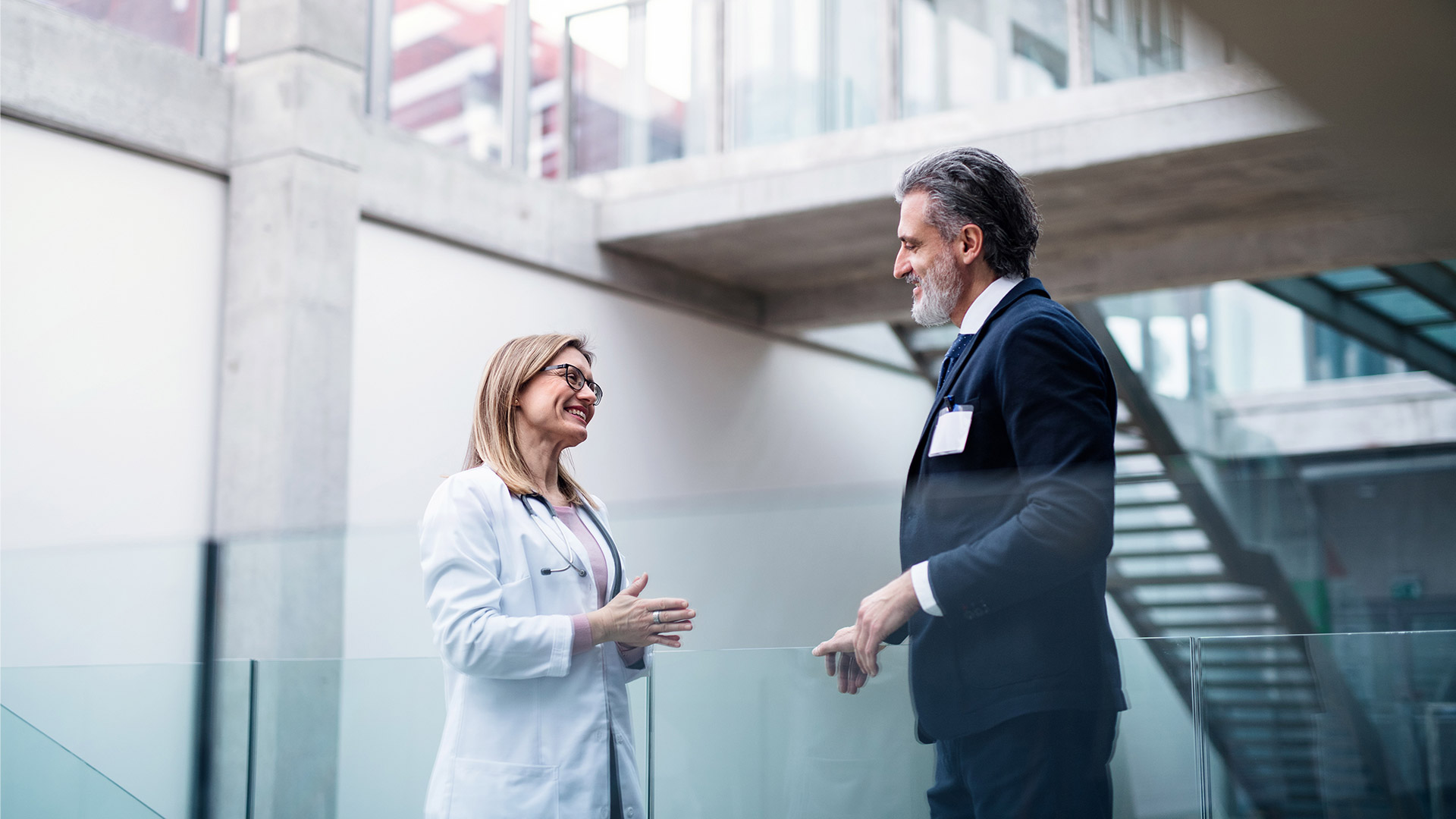 Two healthcare professionals are talking to each other