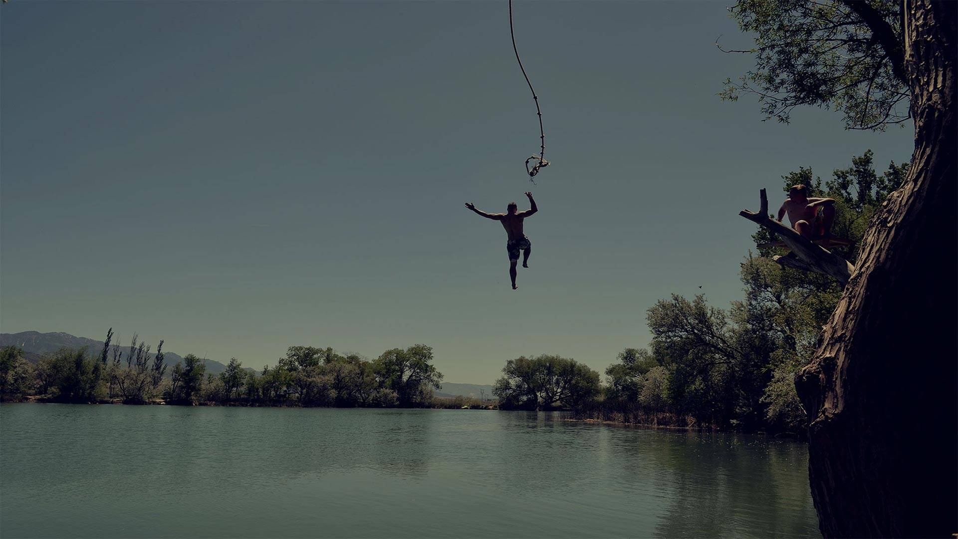 A man is jumping in the water