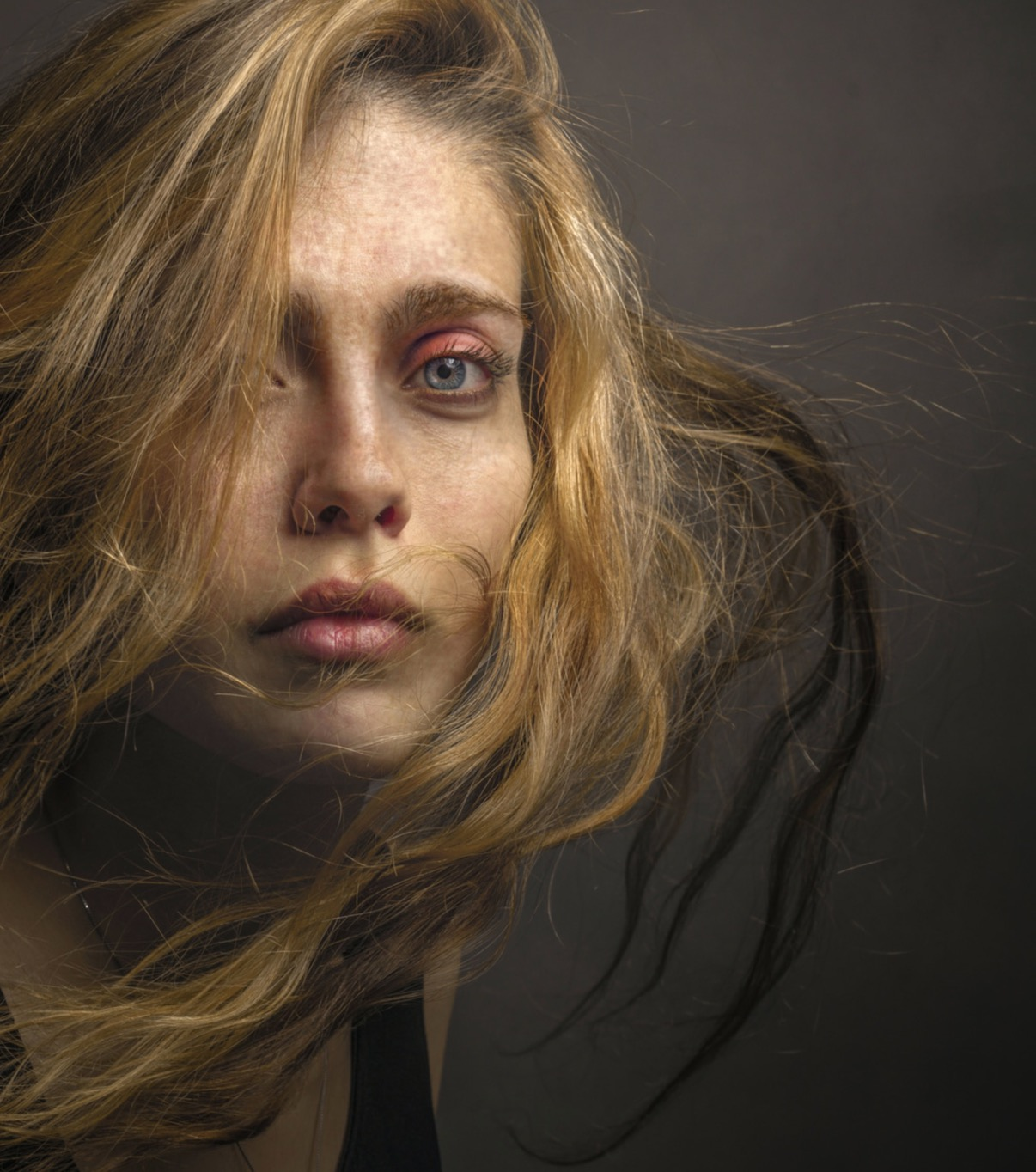 woman with long hair billowing around her face