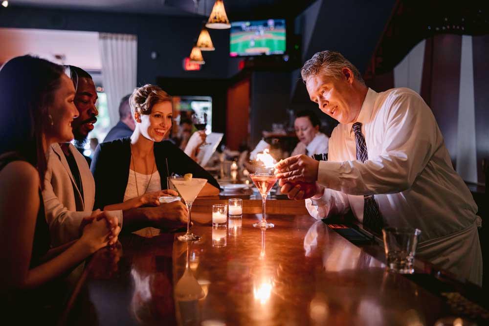gmichaels bartender serving flaming drink