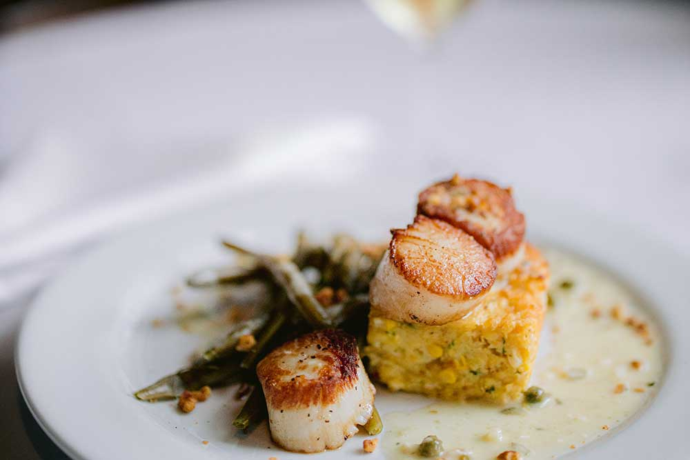 plated scallop dish from gmichaels restaurant in columbus ohio