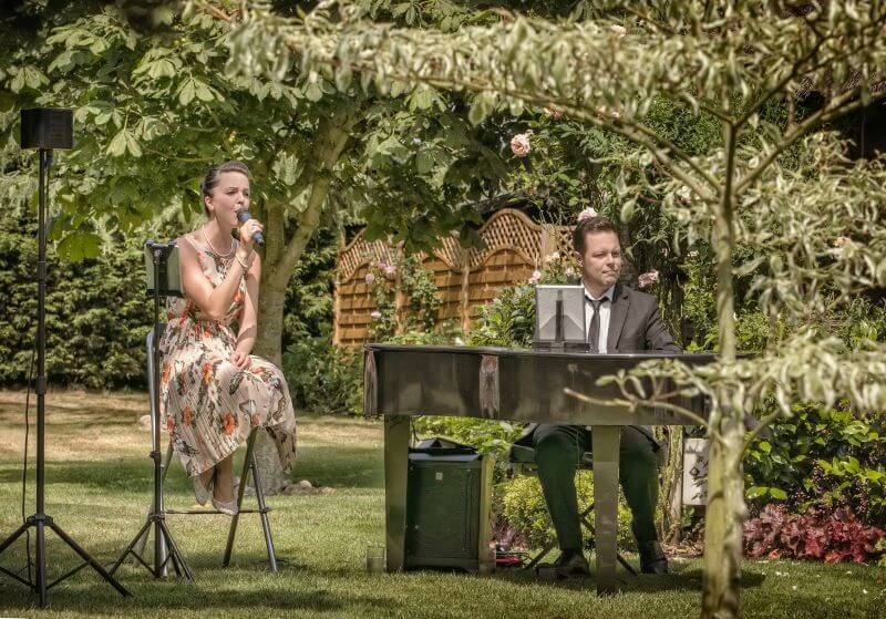 Carly and Russ preforming in North Wales