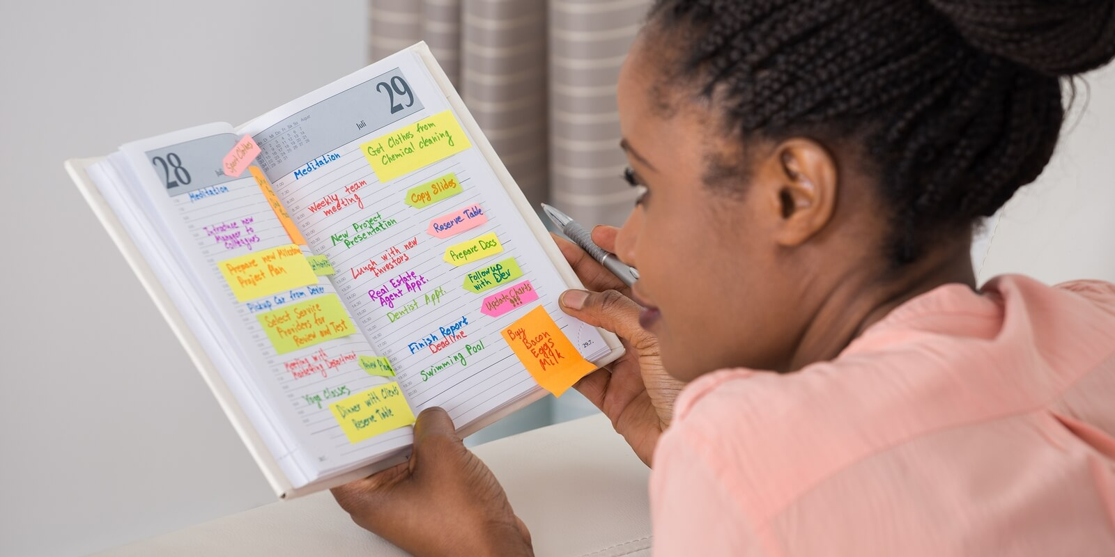 A team member looking at her agenda for her continuing education employee benefits