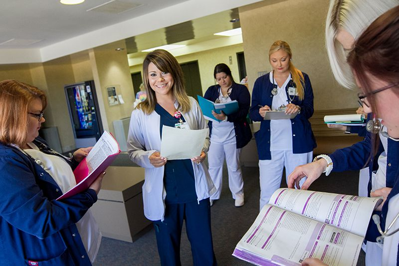 A Baptist Health employee team meeting in a hospital