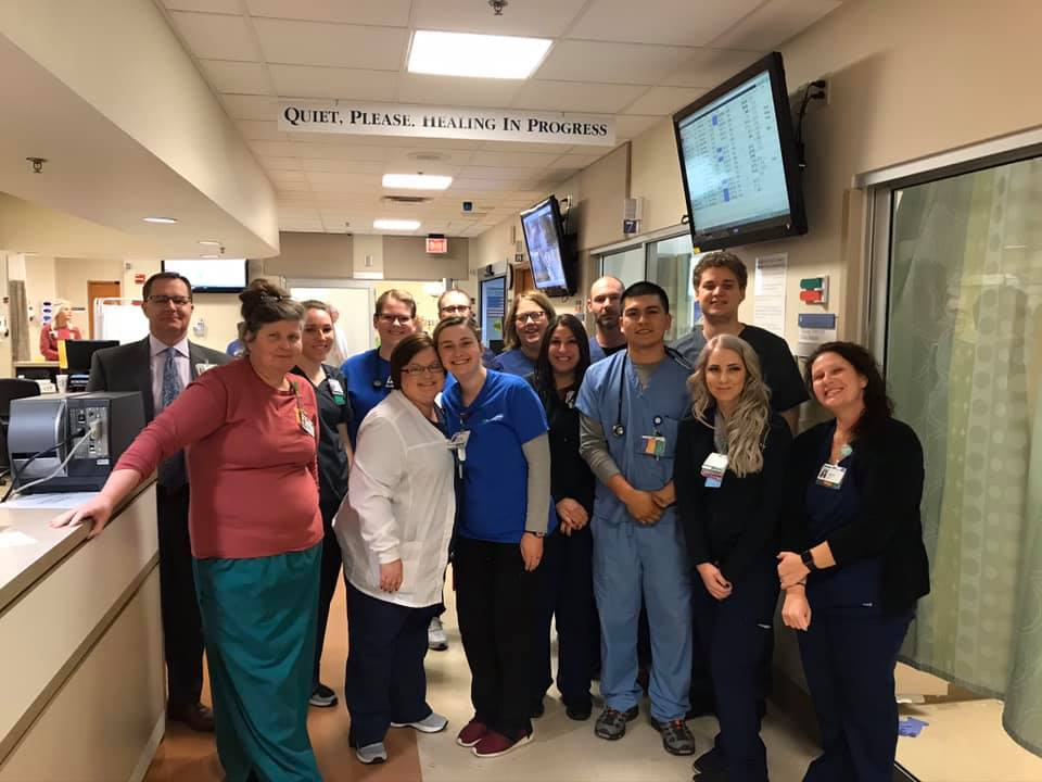 A team of doctors and nurses in a Baptist Health hospital showing team spirit.