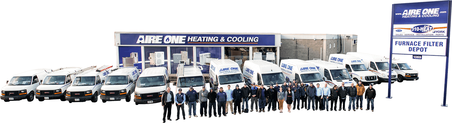 Aire One Team Standing Out Front Of Showroom With Trucks