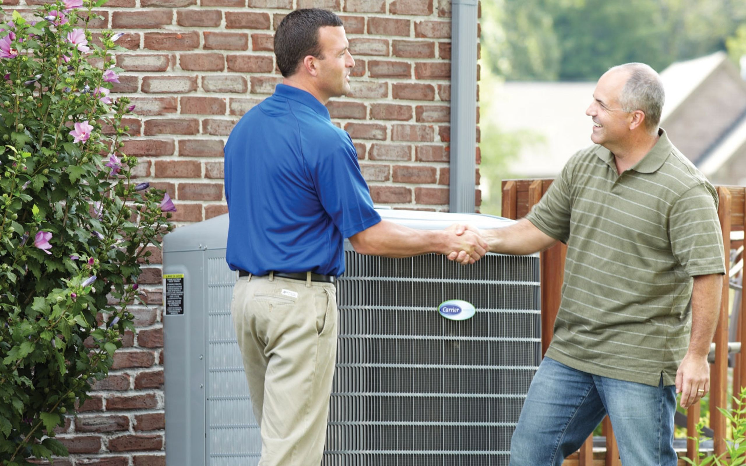 Carrier Rep Shaking Hands With Home Owner