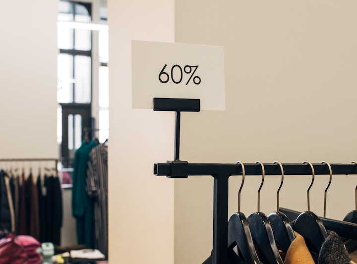 rack with hangers and label about 60% promotion