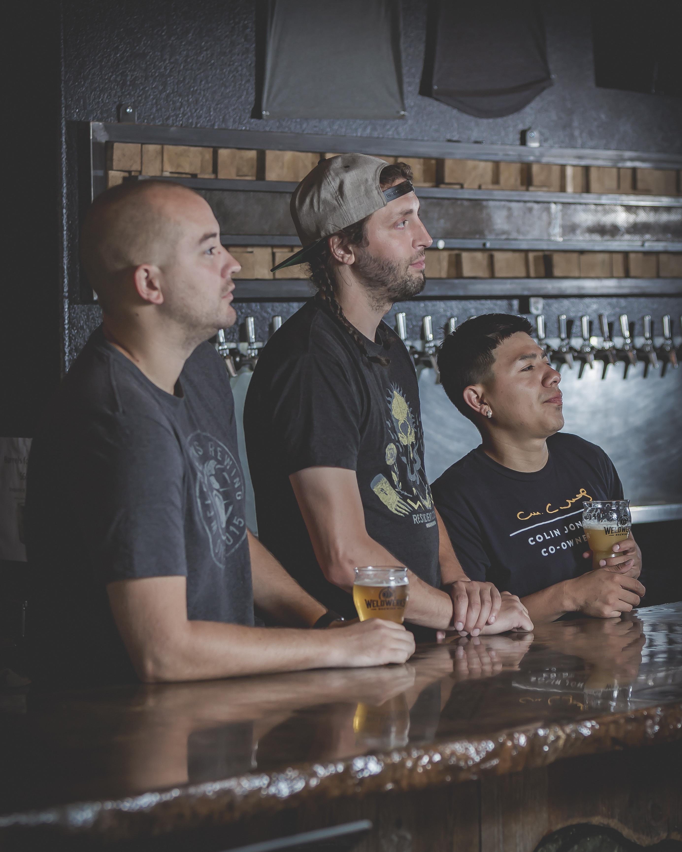 three staff behind bar