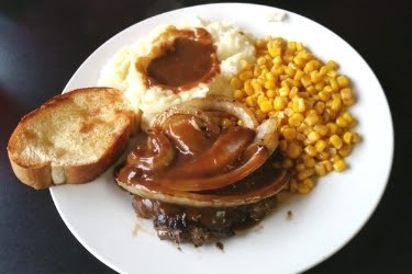 Meat with mash potato corn and gravy
