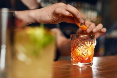 Bar tender serving a cocktail