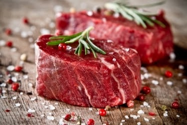 Two pieces of raw steaks