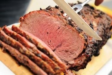 Knife cutting a prime rib