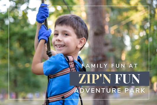 Kid zip lining - Family Fun at Zip N' Fun Adventure Park