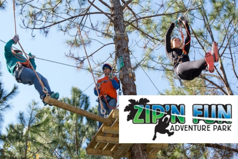 Teenagers doing Zip line - Zip'N Fun Adventure Park
