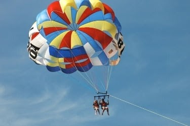 Couple doing parasail