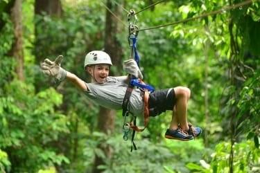 Zip N Fun Adventure Park - Kid doing ziplining