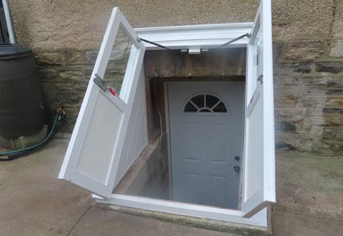 Vinyl Window Wells vinyl stairwell cover with open doors