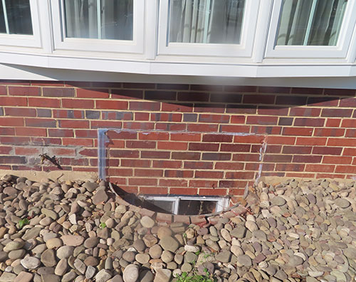 Home basement window well rusted aluminum before Vinyl Window Wells Adapter Cover install