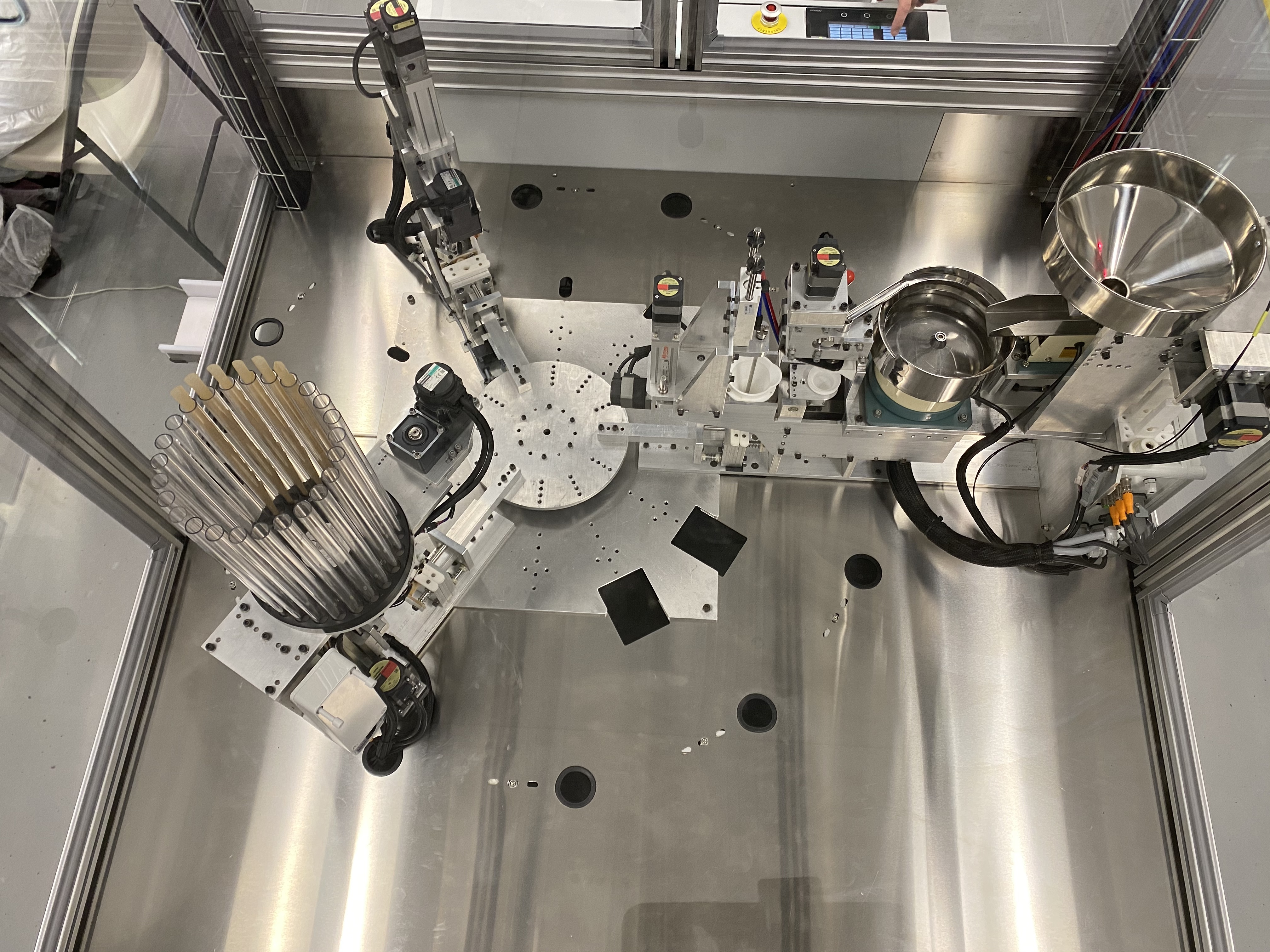 An overhead snapshot of the PRO pre roll machine with 1 group set containing cone magazine, cannabis feeder, weight & compacting station and twisting station.