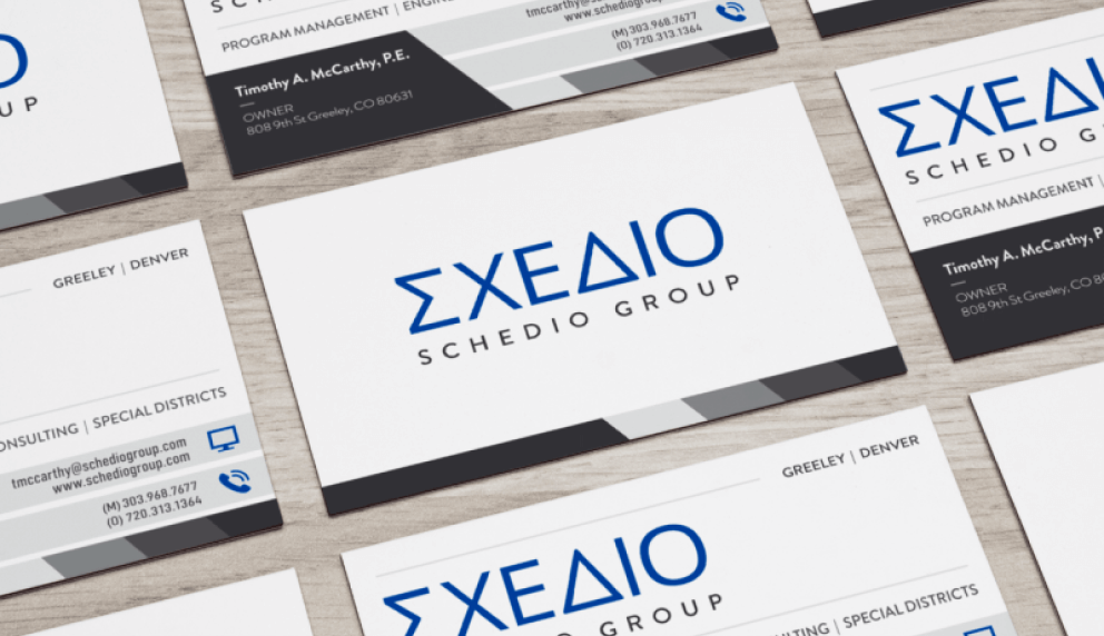 Close-up of white business cards laid out in an angular grid
