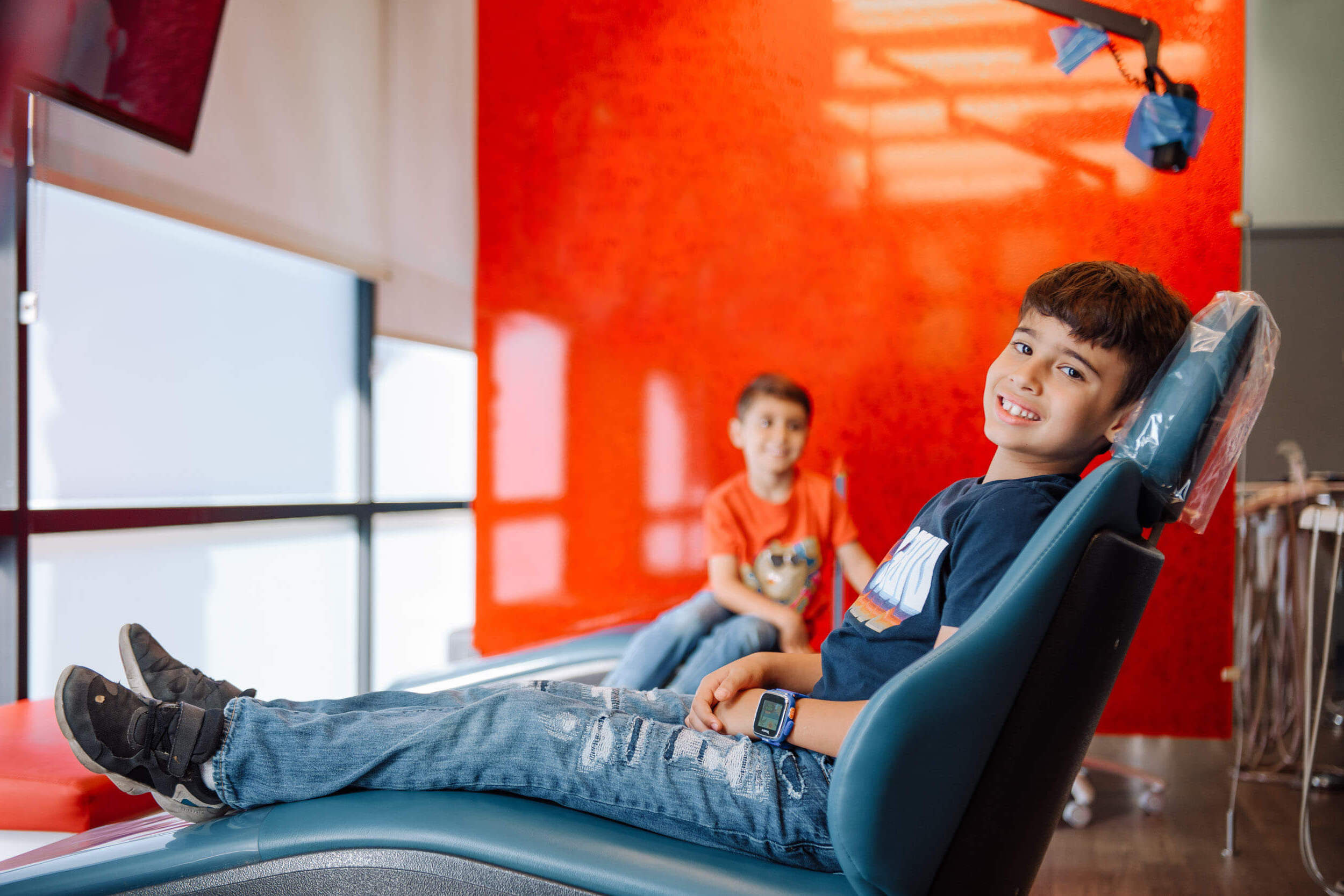 Kid in dental recliner