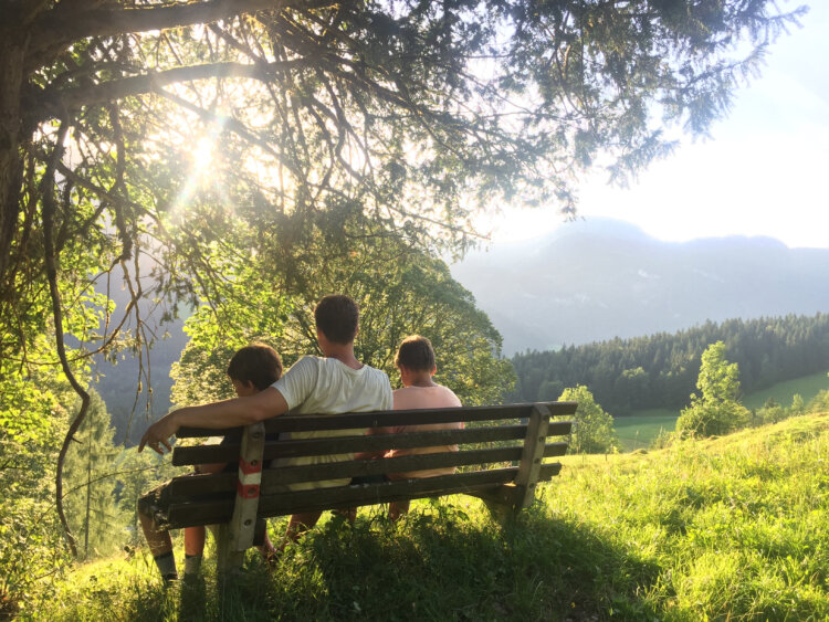 Dad with kids on bench