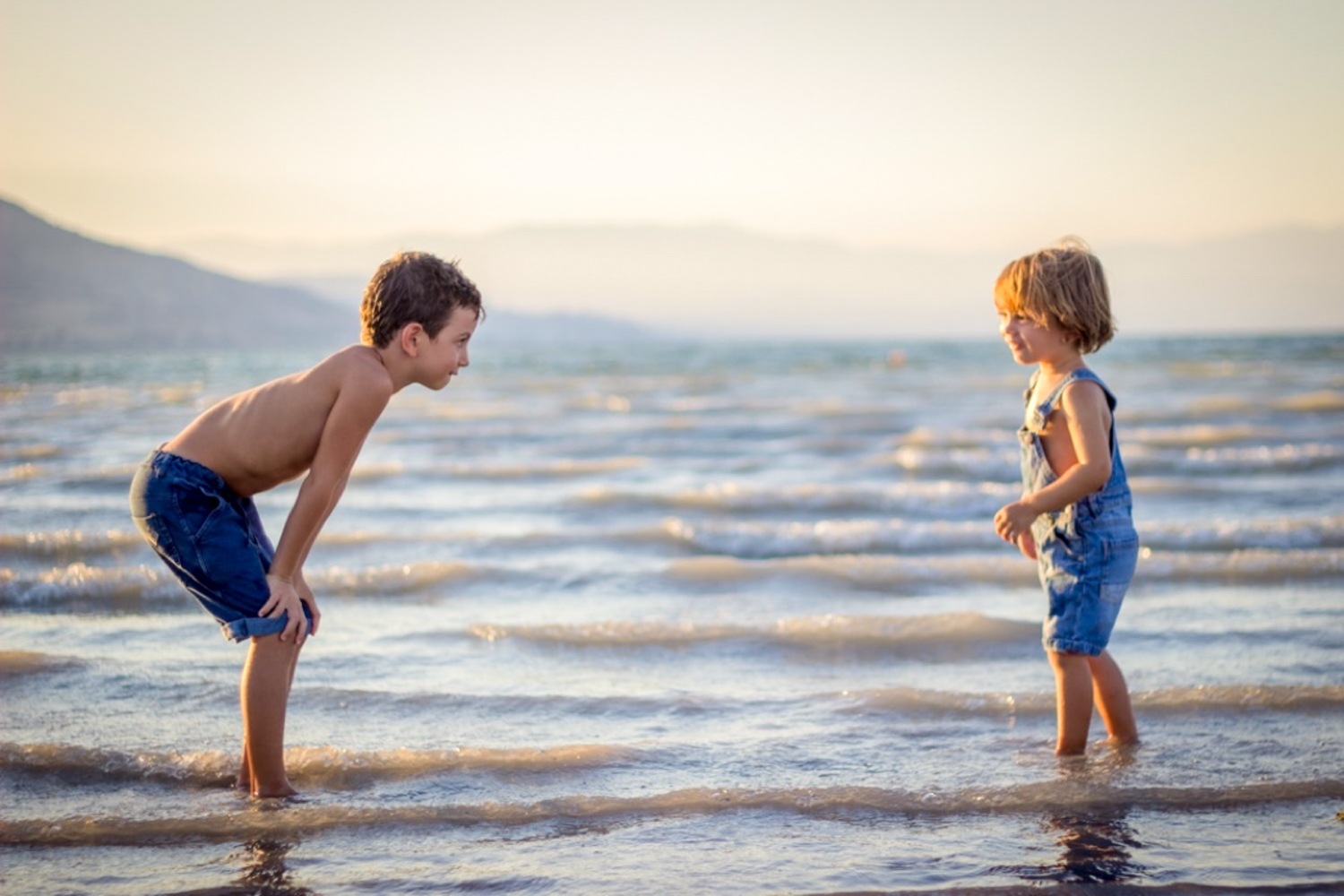 Two Kids Playing in the Sea