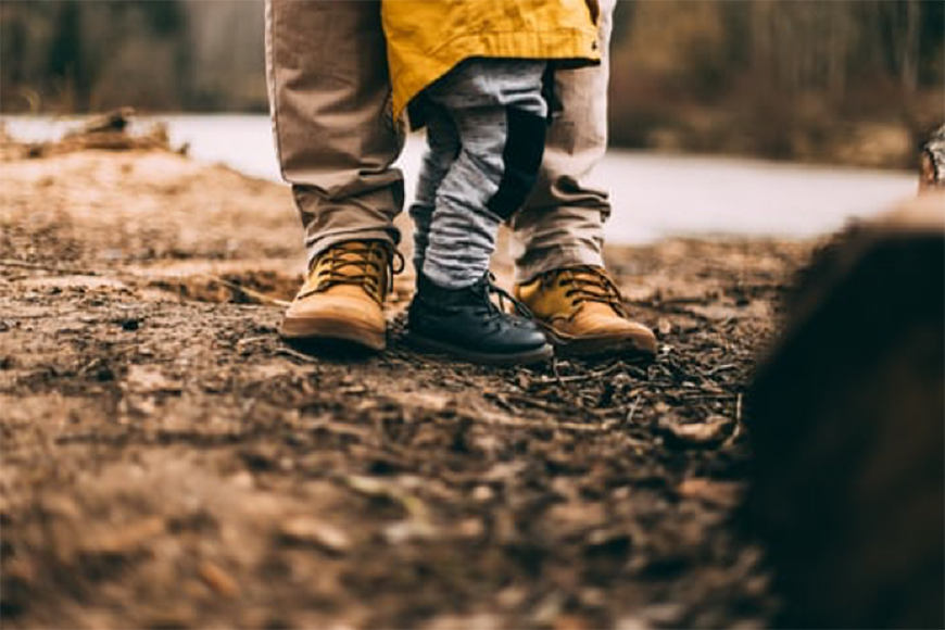 Father with Kid Walking in Forest