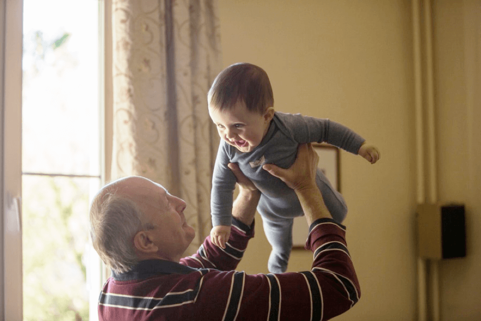 Grandfather Having Fun With Grandson
