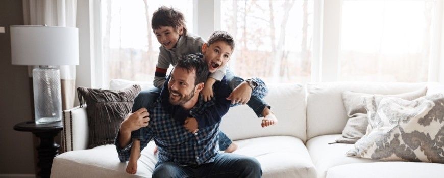 Father with Children Having Fun at Home