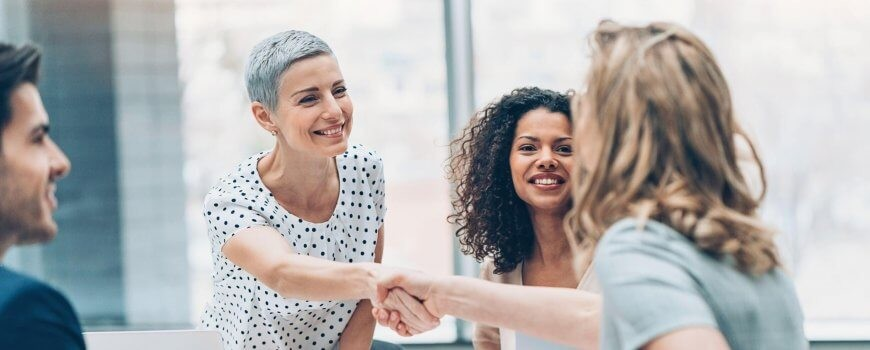 Family Lawyer Shaking Hand of Happy Client
