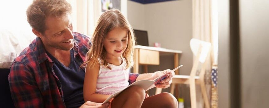 Father on Time-Sharing Reading Book with Daughter