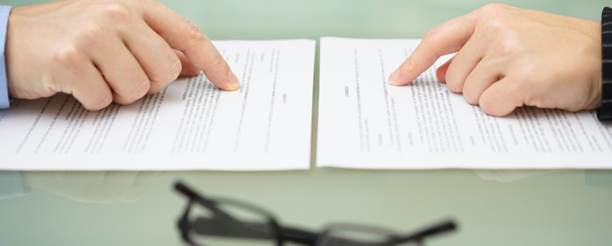 man and wife are reading divorce agreement