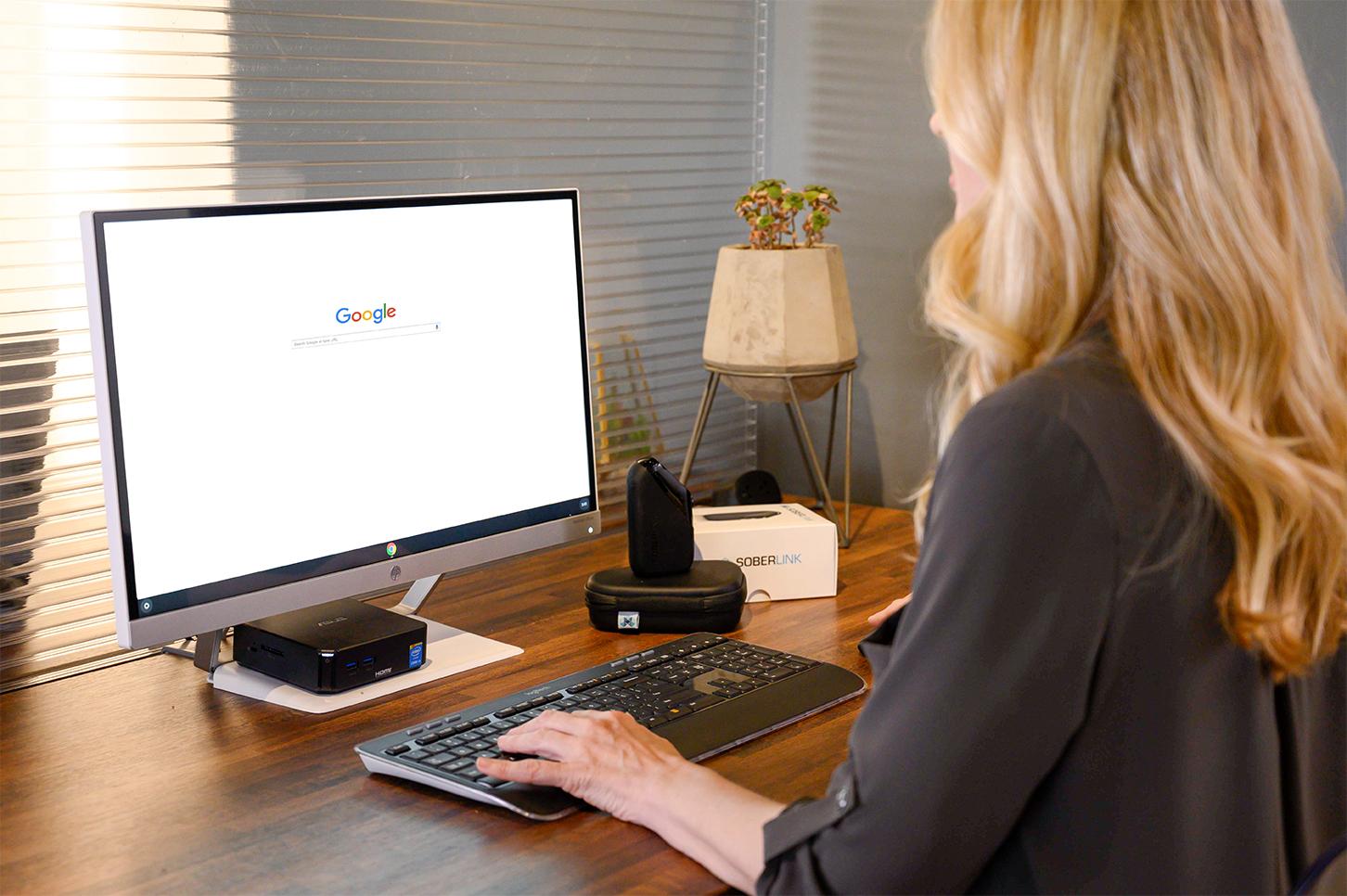 Woman at computer searching Google
