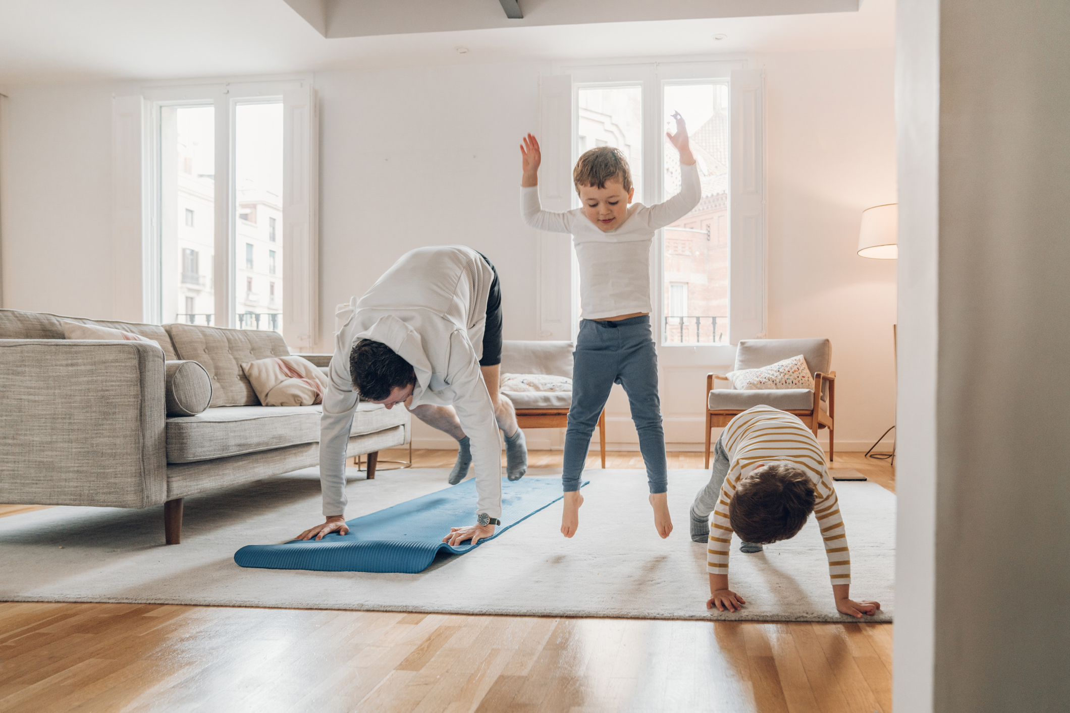 Father Doing Exercise with Two Sons