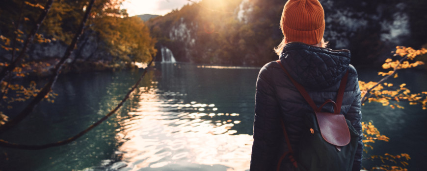 Woman tourist exploring Plitvice Lakes National Park